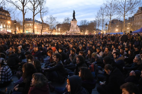 "French protesters gather at Place de La Republique in Paris as part of demonstrations by the Nuit Debout (Up All Night) movement on April 12, 2016. The Nuit Debout or ""Up All Night"" protests began in opposition to the government's labour reforms seen as threatening workers' rights, but have since gathered a number of causes, from migrants' rights to anti-globalisation.  AFP PHOTO / ERIC FEFERBERG / AFP PHOTO / ERIC FEFERBERG"